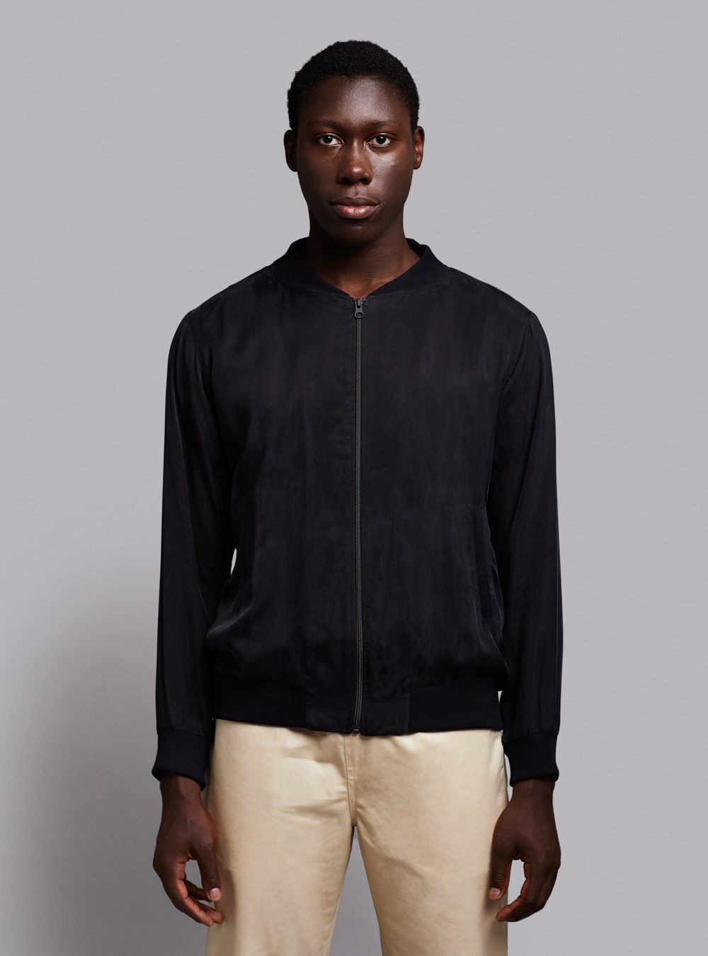 Cupro bomber jacket (black) in vegan silk, made in Portugal by wetheknot.