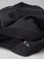 Detail of cupro bomber jacket (black) in vegan silk and its YKK zipper, made in Portugal by wetheknot.