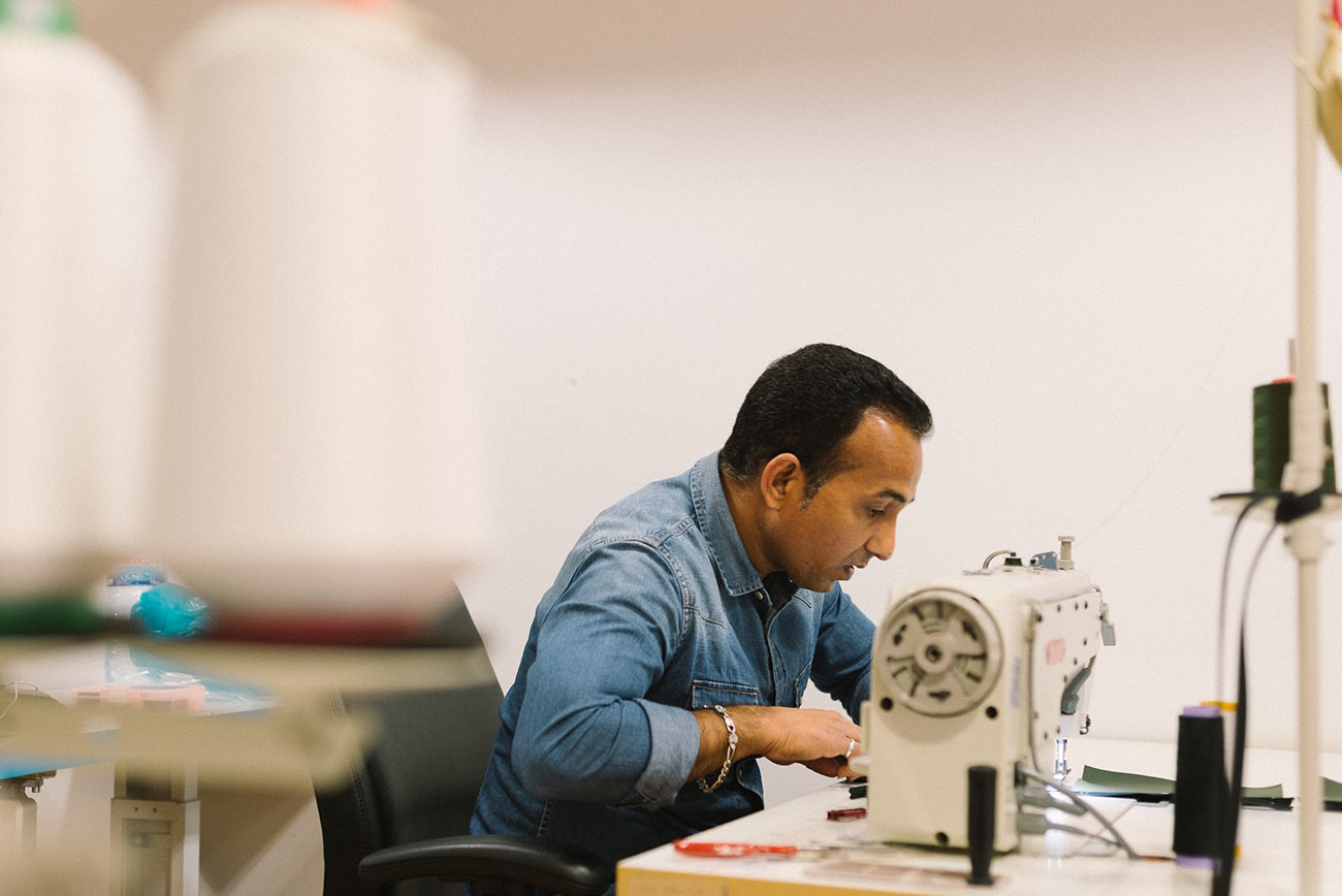 wetheknot studio in Lisbon, Sohil sewing a new piece of the made-to-order collection.
