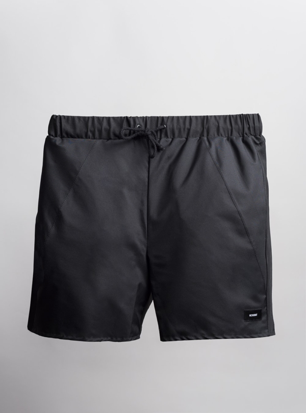 Reversible swim shorts (black) made from upcycled umbrellas found in the streets, made in Portugal by wetheknot