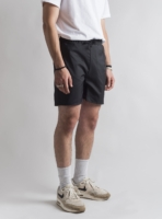 Reversible swim shorts (black) made from upcycled umbrellas found in the streets, made in Portugal by wetheknot on a male model