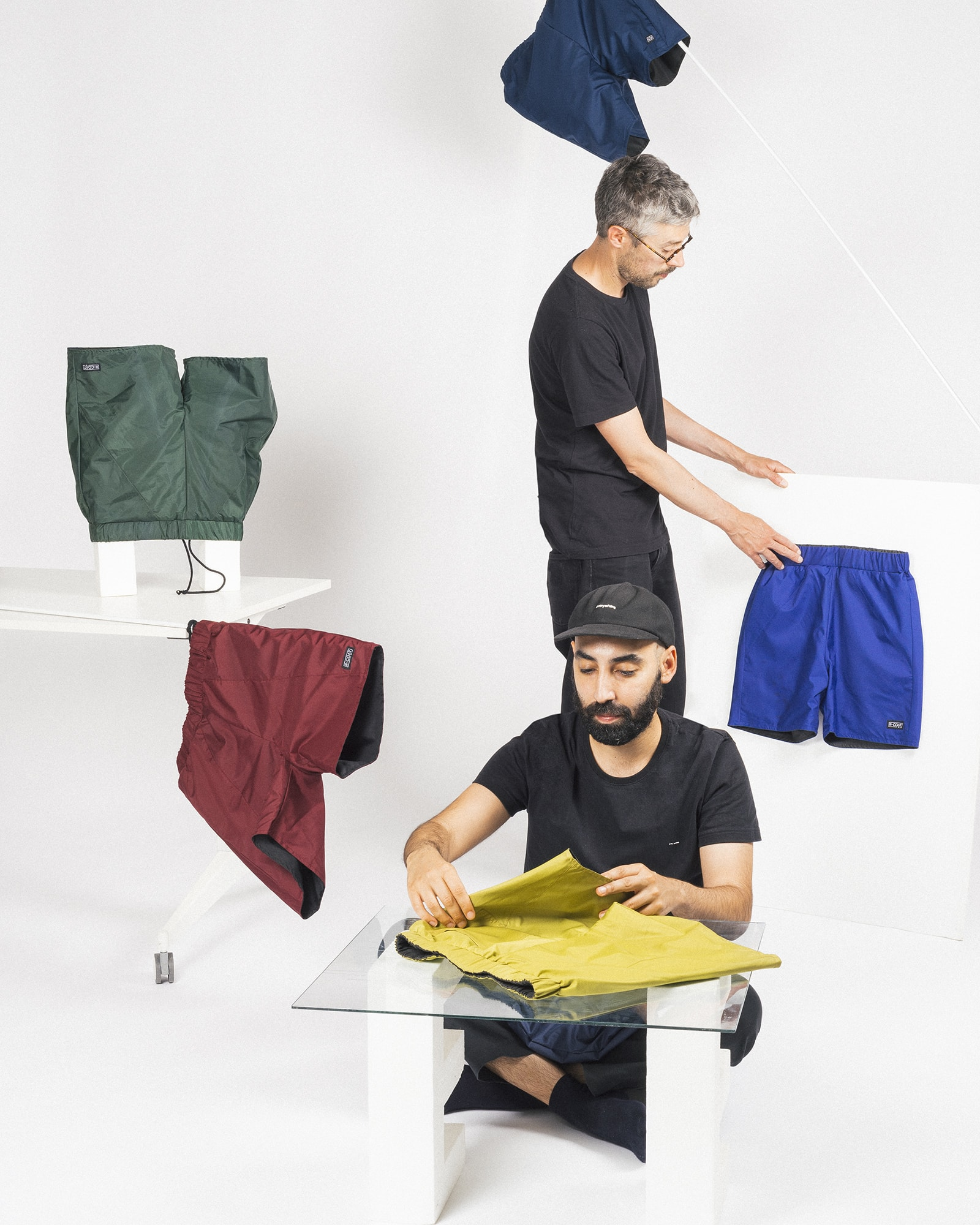Filipe and Sérgio form wetheknot organizing the reversible shorts made from broken umbrellas, made in Lisbon, Portugal